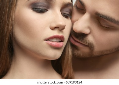 Portrait of sexy young couple, closeup