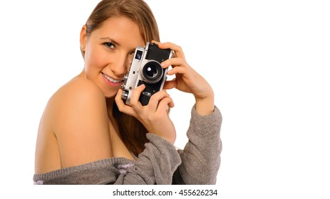 portrait of a sexy young girl with photo camera