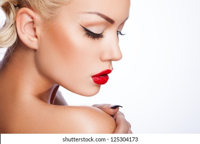 portrait of sexy young woman with creative hair style and chubby red lips