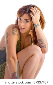 Portrait of a sexy young woman with multiple tattoos