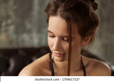 Portrait of a sexy young woman in a white shirt.