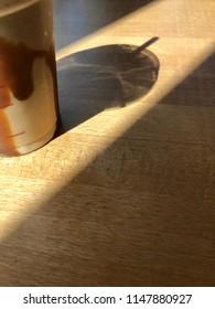 Portrait shadow shot of cold takeaway drink