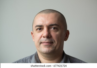 Portrait of a Shaved Head Man closeup photo