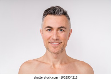 Portrait of a shirtless good-looking caucasian man isolated over white background