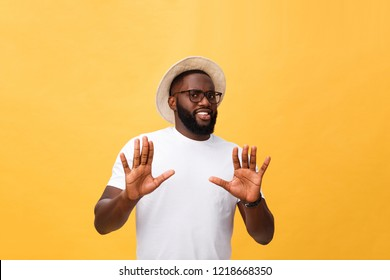 Portrait shock and annoyed displeased young man raising hands up to say no stop right there isolated orange background. Negative human emotion, facial expression, sign, symbol, body language