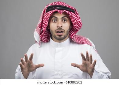 Portrait of a shocked Arabian man, Arabian guy shocked