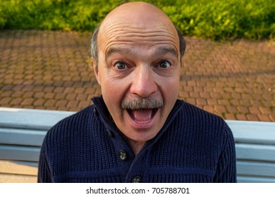 Portrait of shocked caucasian man. He is amazed with unexpected positive news