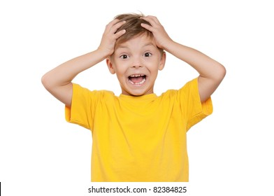 Portrait of shocked little boy with hands on head over white background
