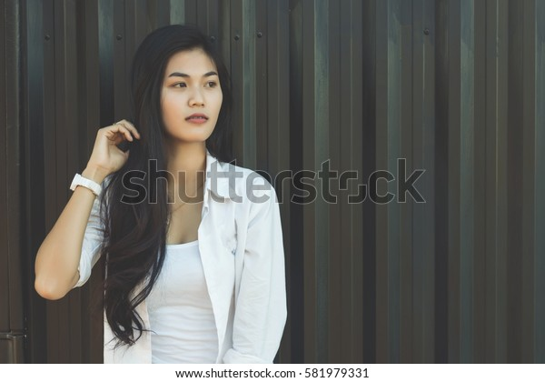 Portrait shooting for beautiful Asian woman and Cargo Containers for background.