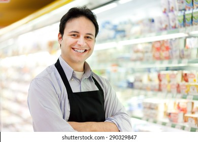 Portrait of a shopkeeper in his store
