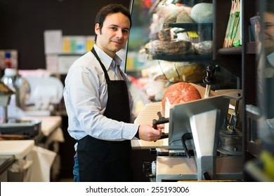 Portrait of a shopkeeper at work in a grocery store