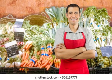 portrait of shopman at the vegetables store with crossing arms