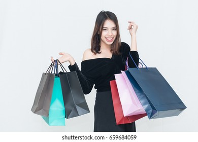 Portrait of Shopping young smile woman holding shopping bags