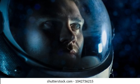 Portrait Shot of the Courageuos Astronaut  Wearing Helmet in Space, Looking around in Wonder. Space Travel, Exploration and Solar System Colonization Concept.