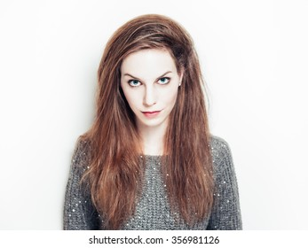 Portrait shot of young beautiful woman with blue eyes, combed hair, full red lips and clean white skin on white background.