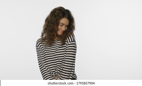 Portrait of shy woman on white background. Shy girl in studio. Young woman with shy face expression. Timid girl flirting