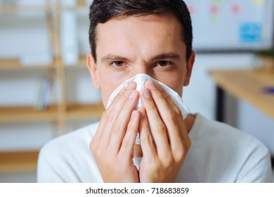 Portrait of sick male that posing on camera
