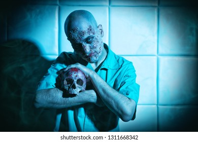 A portrait of a sick scientist after a failed experiment in the blue light holding a skull. desperation, hopelessness. Horror, halloween.