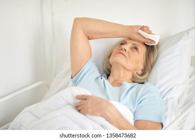Portrait of a sick senior woman in hospital