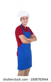 a portrait of a side view a young smiling chef is standing arms crossed isolated on a white background