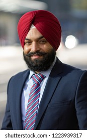 Portrait of Sikh business man smiling to camera