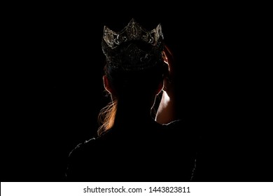 Portrait Silhouette Shadow Back Rim Light of Miss Pageant Beauty Queen Contest Silver Diamond Crown wave hand express feeling smile, studio lighting dark black background, turn back head to camera