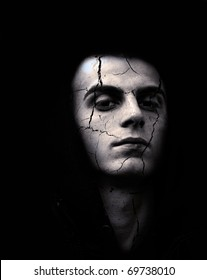 portrait of sinister,spooky looking man with cracked skin