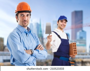 Portrait of a site manager and a bricklayer