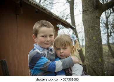 Portrait sitting hugging brother and Setra in rural areas
