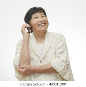 Portrait of a sixty years old woman who use a mobile phone