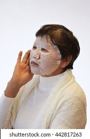 Portrait of a sixty years old woman with facial mask