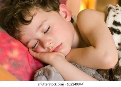 A portrait of a sleeping 4-year boy