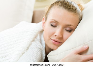Portrait of sleeping beautiful woman on bed at bedroom