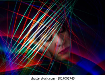 Portrait Of Sleeping Woman With Colorful Streaks Of Lights Creating Patterns Around Her Head. Dreams, Fantasies. Thoughts. Ideas.