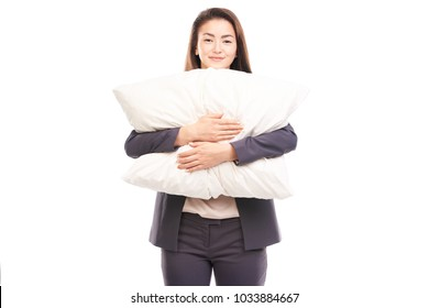 Portrait of sleepy businesswoman posing with pillow
