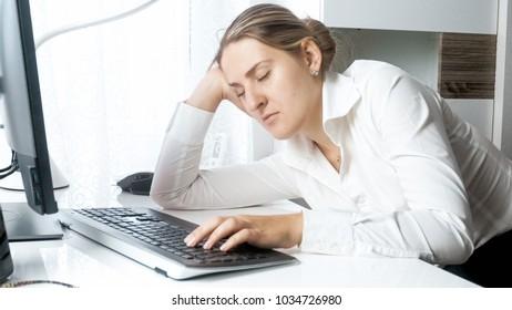 Portrait of sleepy businesswoman working at office