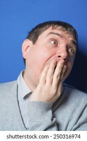 Portrait of a sleepy man yawning