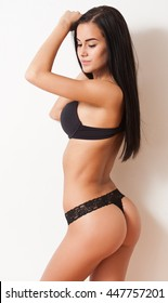 Portrait of slim young brunette beauty in fashionable lingerie.