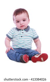 Portrait of small boy in blue trousers striped t-shirt