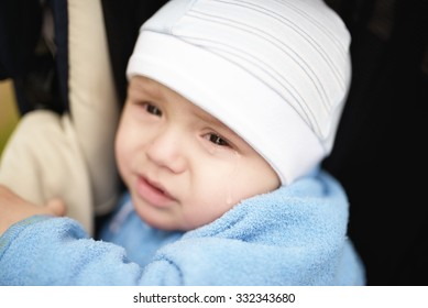 Portrait of the small crying baby