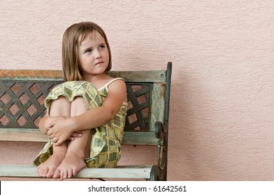 Portrait of small cute girl looking to side with copy space