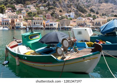 Portrait of a small fishing boat in the port of Symi in Greece