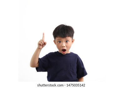 Portrait of smart Asian boy pointing up, showing that he get some ideas, isolated on white background.