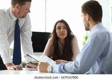 Portrait of smart businesswoman sitting in modern office and discussing important business project and strategy. Classy businessman looking at lady. Biz meeting concept. Blurred background
