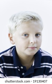 portrait of a smart caucasian expressive kid on indoor isolated background