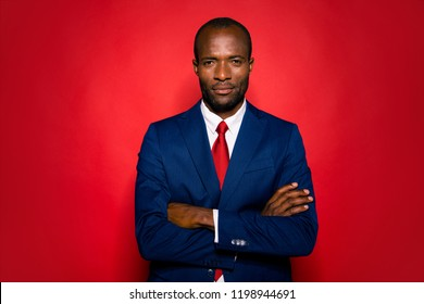 Portrait of smart clever content calm experienced well-groomed attractive handsome hr director man folded arms in suit isolated over bright vivid red background