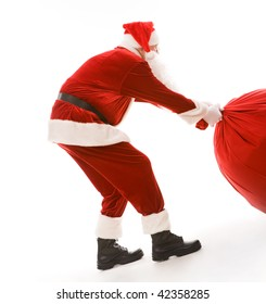 Portrait of smart Santa carrying heavy big red sack with presents
