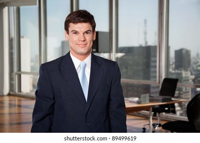 Portrait of smart well-dressed male entrepreneur smiling