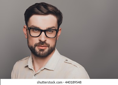 Portrait of smart young handsome bearded man in glasses