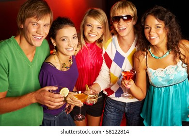 Portrait of smart young people looking at camera while toasting